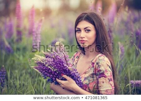 Beautiful girl longo cabelo escuro campo brilhante vermelho Foto stock © ElenaBatkova