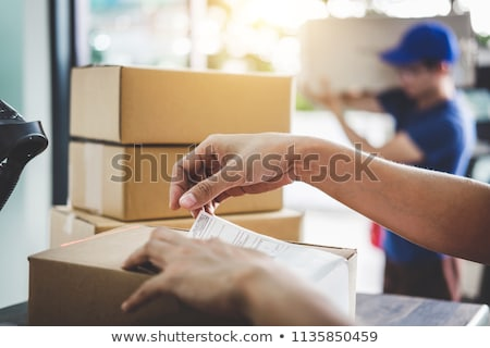 Man Work as Courier at Post Office, Parcel Boxes Stock photo © robuart