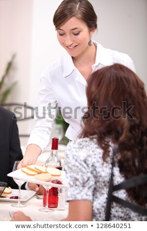 Stock photo: Waitress serving a pate starter in a restaurant
