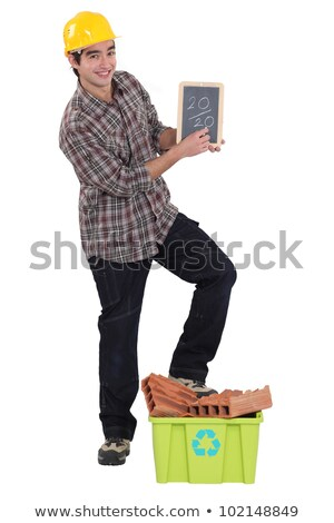 builder stood with chalk board and recyclable waste material stock photo © photography33