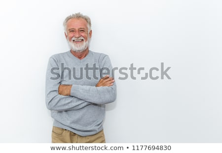 cheerful old man standing with arms crossed stock photo © stockyimages