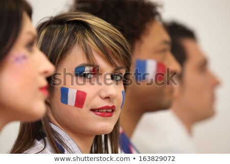 friends watching the french team play a soccer game stock photo © photography33
