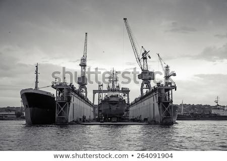 silhuetas · nublado · céu · trabalhar · navio · industrial - foto stock © lizard