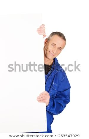 dojrzały · wskazując · billboard · portret · biały - zdjęcia stock © wavebreak_media