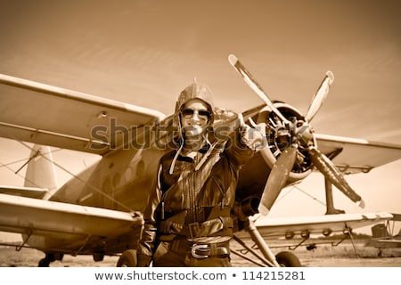 Beautiful woman aviator: vintage photo Stock photo © stokkete