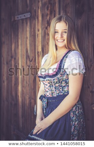 Woman in traditional Bavarian clothes or dirndl on festival Stock photo © Kzenon