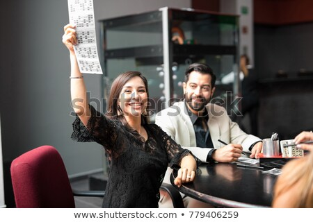 Csinos fiatal nő hazárdjáték kéz asztal jókedv Stock fotó © pxhidalgo