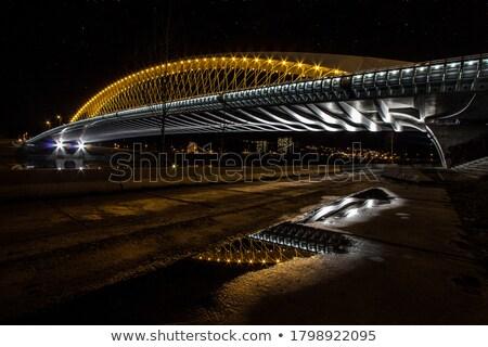 Reflexão ponte luzes rio noite céu Foto stock © Kayco