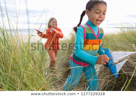 Bambini giocare inverno spiaggia bambino autunno Foto d'archivio © monkey_business