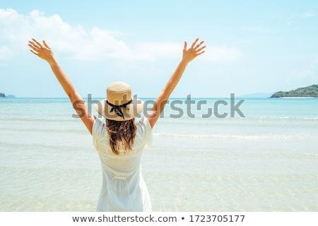 Woman Enjoying Beach Holiday Stock photo © monkey_business