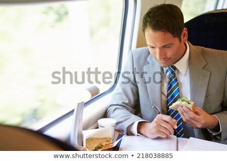 Stock fotó: üzletember · eszik · szendvics · vonat · utazás · étel