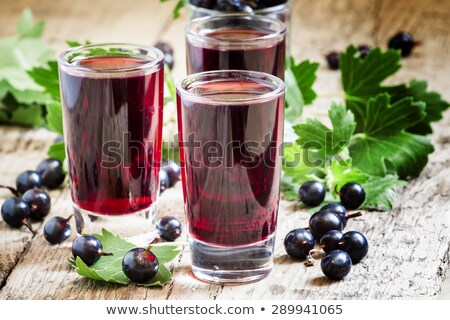 Black currant on the old wooden table Stock photo © inxti