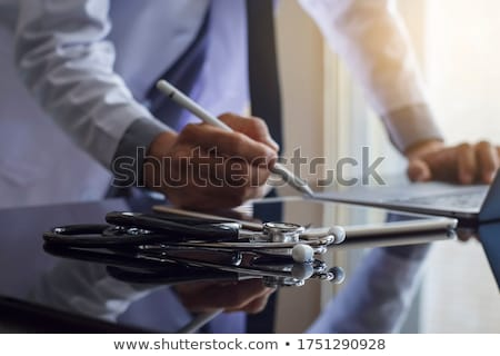 Doctor with a stethoscope in the hands Stock photo © vlad_star