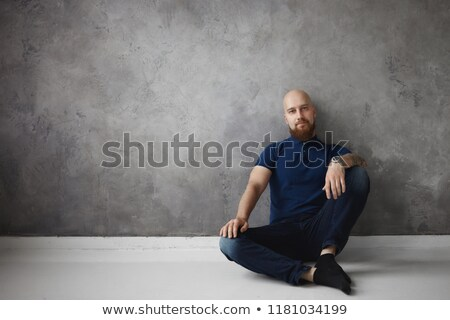 young fashion man relaxing on one knee stock photo © feedough
