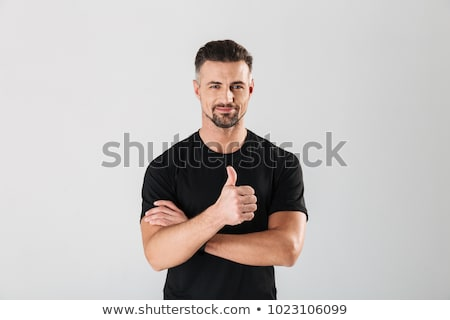 fitness man showing thumb up stock photo © deandrobot