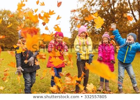 Csoport boldog ősz gyerekek mosolyog tél Stock fotó © godfer