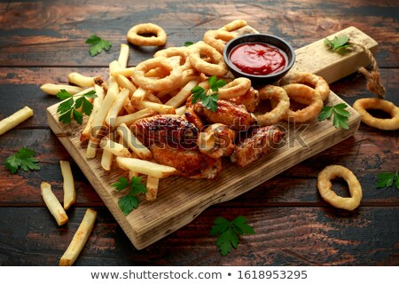 Stock photo: Chicken wings and potatoes