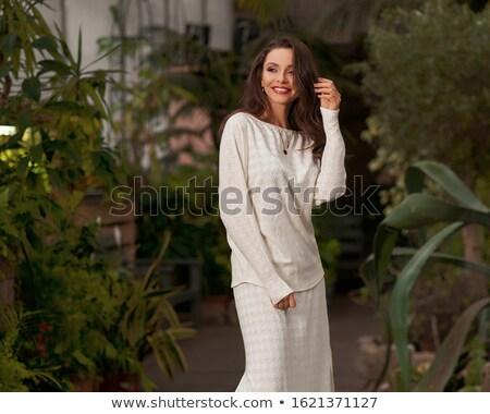 Retrato modelo invernadero vestido rojo posando Foto stock © deandrobot