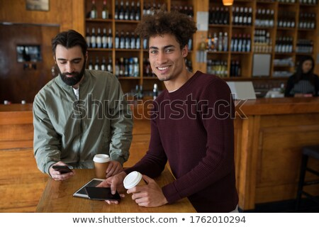 two male friends using mobile phone while having coffee stock photo © wavebreak_media