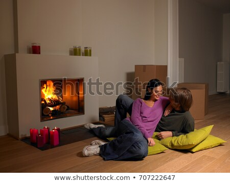 Couple with moving boxes, fire place Stock photo © IS2