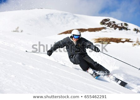 Man in black suit carving off piste. Stock photo © IS2