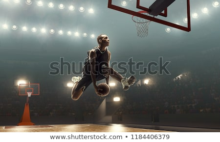 Basketball player jumping at goal hoop Stock photo © IS2