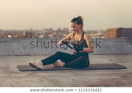 Coach wrapping woman's hands on rooftop Stock photo © IS2