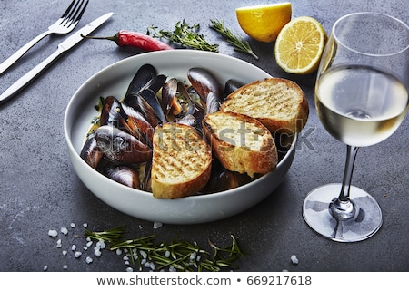 Meal of seafood with white wine Stock photo © bluering