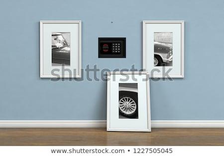 hidden closed wall safe behind picture stock photo © albund