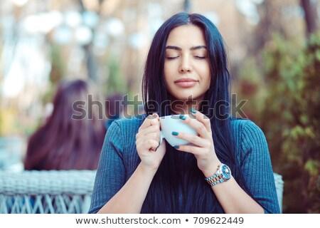 Portrait of a relaxed latina lady drinking coffee Stock photo © konradbak