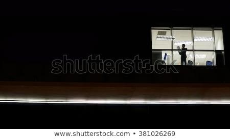 Empresário escritório noite jovem bonito trabalhando Foto stock © ra2studio