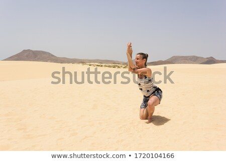 girl with horse posing in the dunes stock photo © compuinfoto
