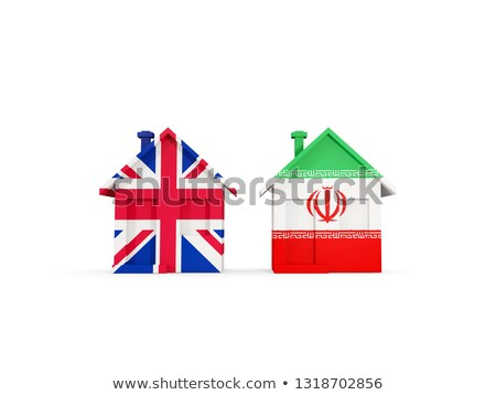 Stock photo: Two houses with flags of United Kingdom and iran