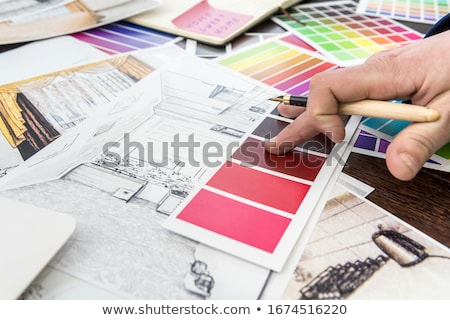 designers with blueprint and color samples stock photo © dolgachov