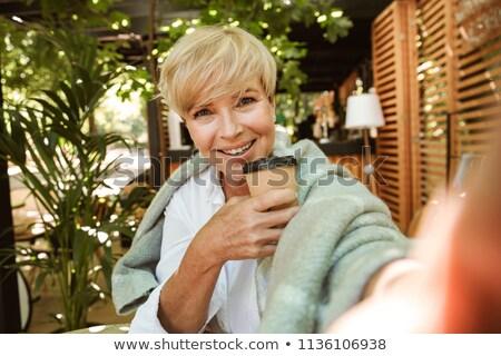 smiling senior woman with takeaway coffee cup Stock photo © dolgachov