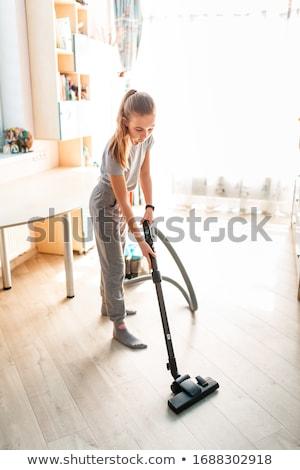 Teenage girl cleaning her room with vacuum cleaner Stock photo © Len44ik