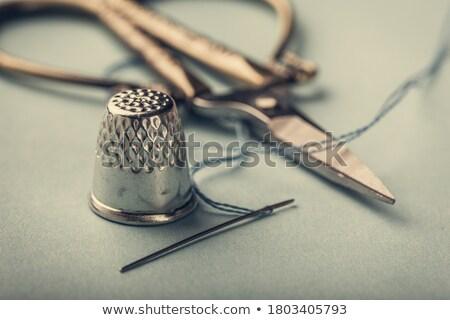 Vintage plata dedal azul metal aguja Foto stock © Melnyk
