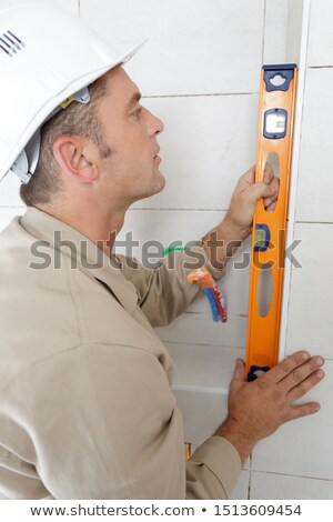 Middle-aged manual worker holding spirit-level Stock photo © photography33