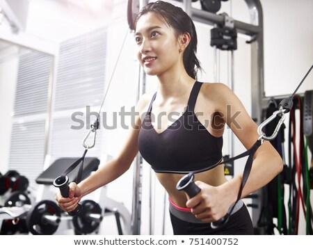 Mosolygó nő sportok apparátus sport fitnessz tornaterem Stock fotó © photography33