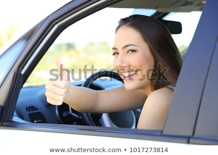 seated woman with thumbs up gesture stock photo © stockyimages