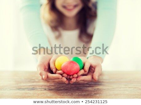 close up of a woman showing colorful easter eggs stock photo © wavebreak_media