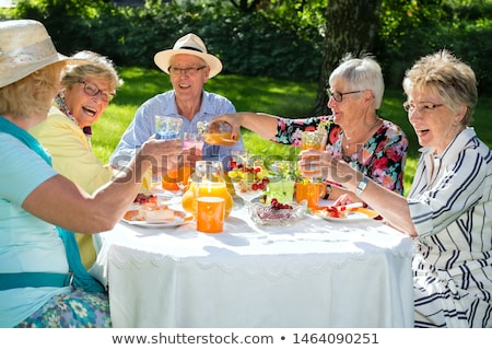 Ancianos dama potable jugo de fruta mujer alimentos Foto stock © photography33