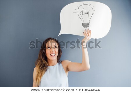 Young woman in thinkers pose against a white background Stock photo © wavebreak_media