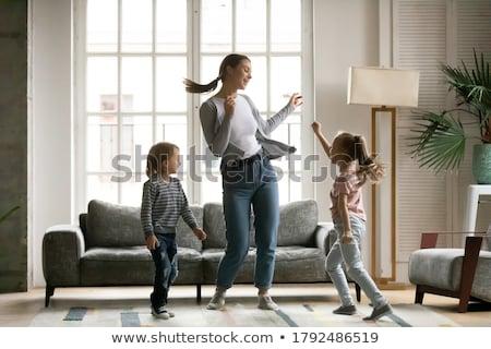 bonitinho · pequeno · menino · risonho · sofá · casa - foto stock © hasloo