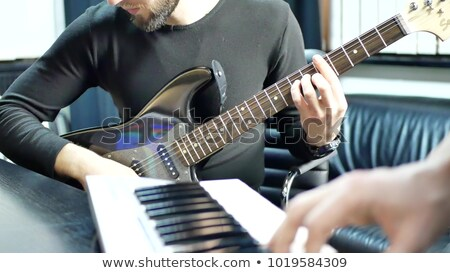 Musicien jouer électronique piano fond clé Photo stock © vinodpillai