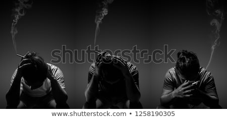 portrait of a young man with a cigarette Stock photo © evgenyatamanenko