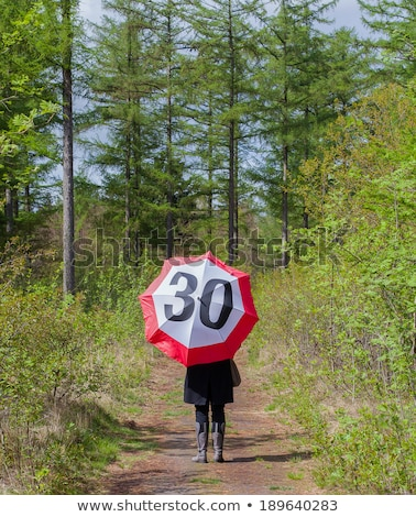 Woman in the forrest with a traffic sign umbrella Stock photo © michaklootwijk