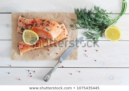 red fish fillet and knife close-up  Stock photo © OleksandrO