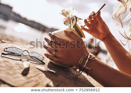 close up of woman with cocktail ring on hand stock photo © dolgachov