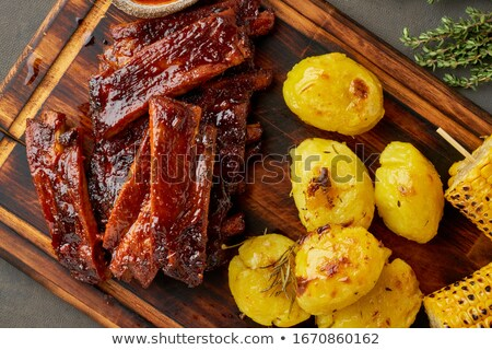 Stock photo: Smoked pork and crushed potatoes